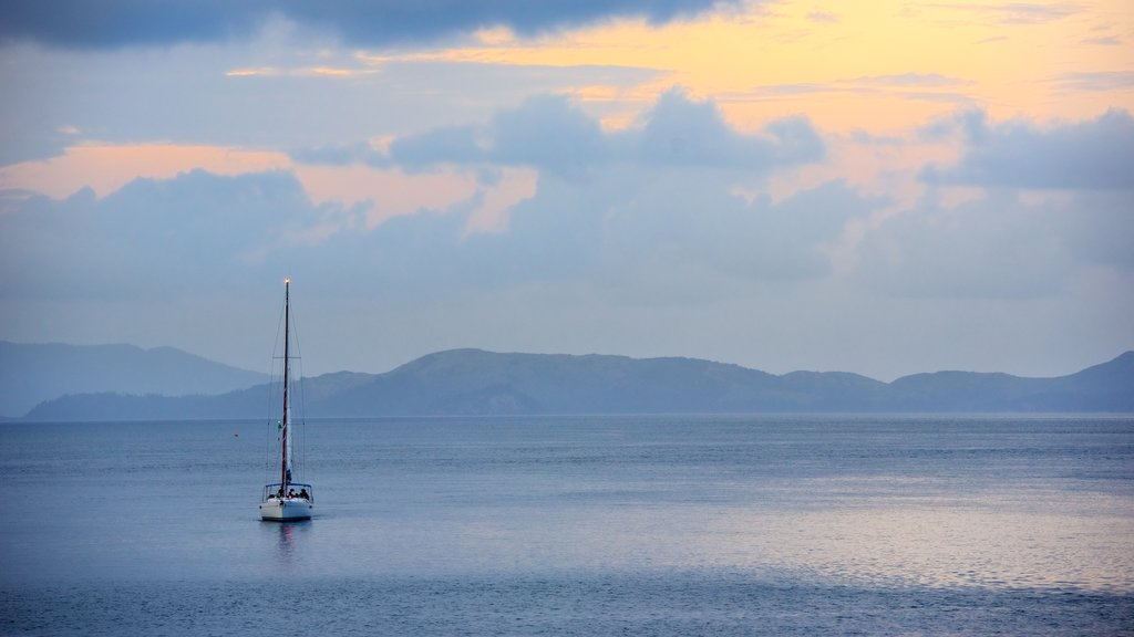 Hamilton Island which includes sailing, a sunset and landscape views