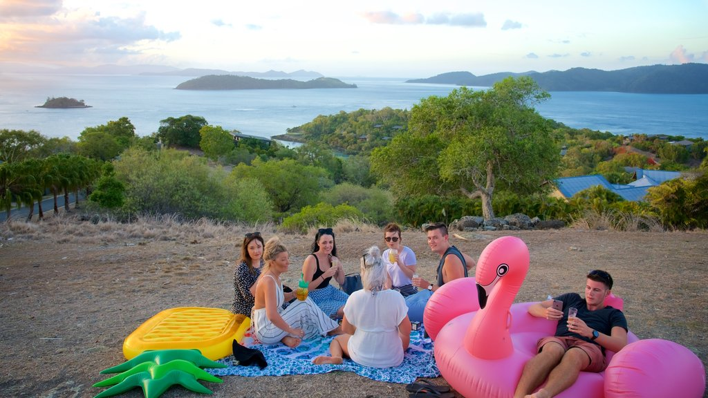Hamilton Island featuring general coastal views and landscape views as well as a small group of people