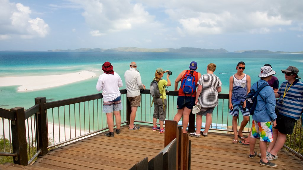 Hamilton Island showing views and general coastal views as well as a small group of people