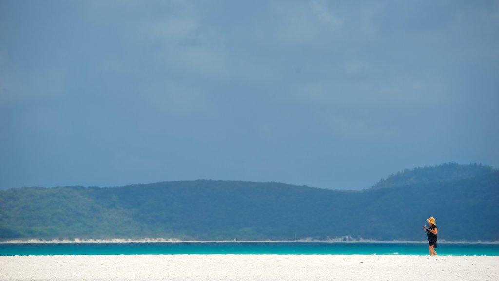 Hamilton Island featuring a sandy beach as well as an individual femail