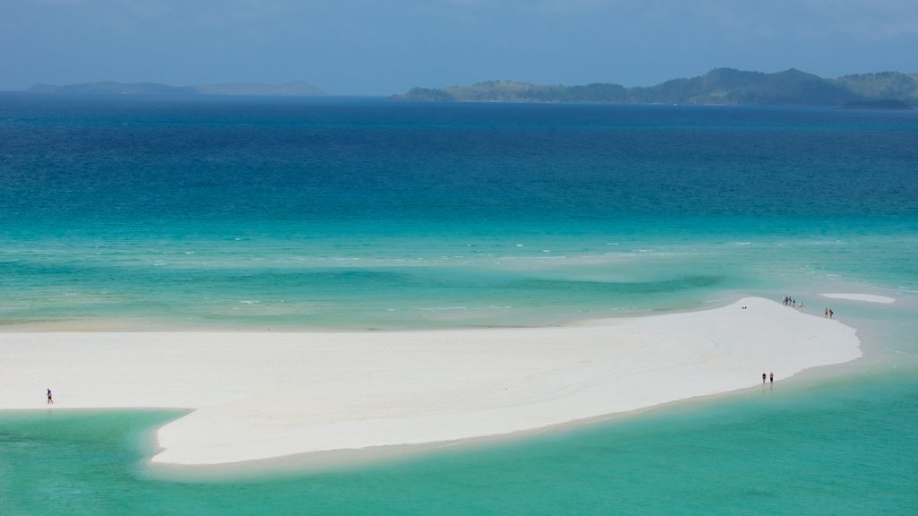 Whitehaven Beach featuring tropical scenes, general coastal views and a beach