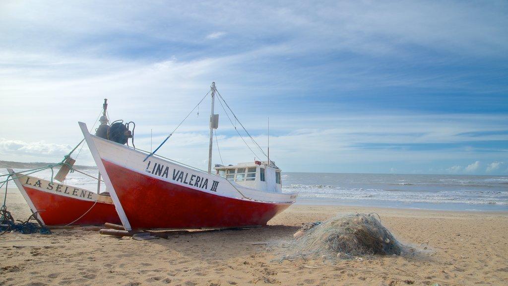 Punta del Diablo mostrando señalización y vistas generales de la costa