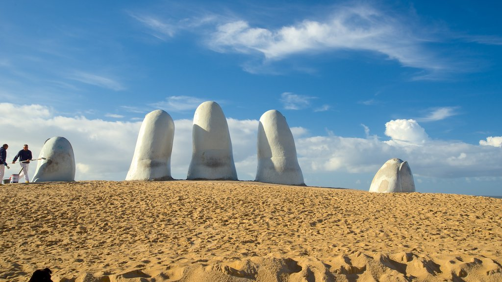 Brava Beach which includes a statue or sculpture, general coastal views and outdoor art