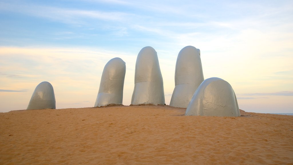 Brava Beach which includes outdoor art, a statue or sculpture and general coastal views