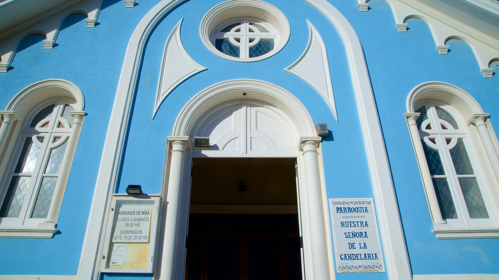 Candelaria Church which includes signage, heritage architecture and a church or cathedral