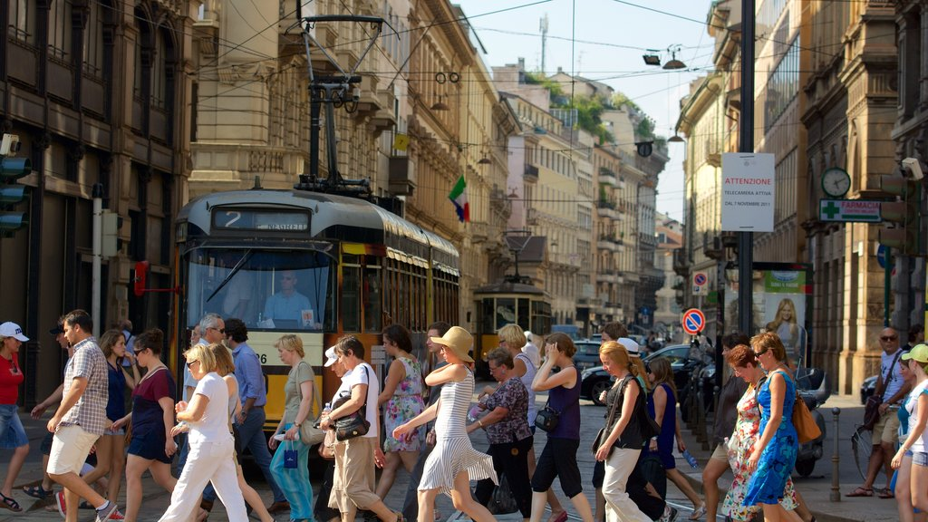 Milan which includes street scenes, a city and railway items