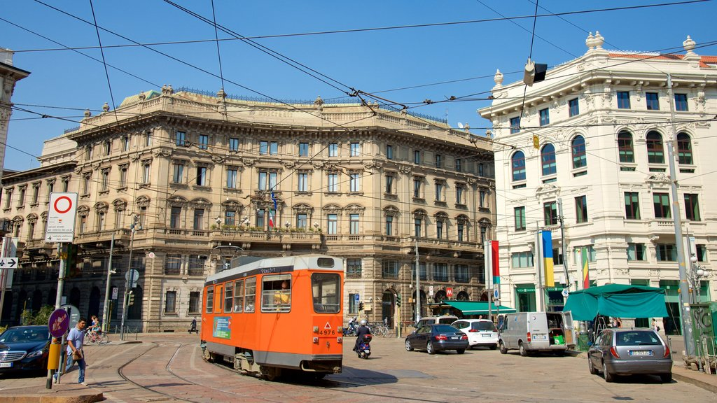 Milan which includes street scenes, railway items and a square or plaza
