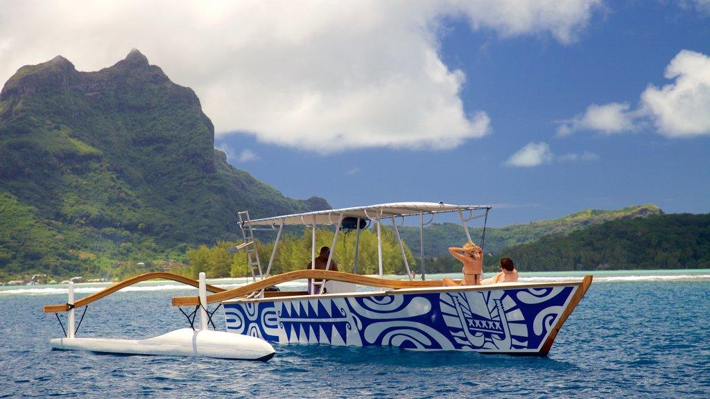 Bora Bora que incluye paseos en lancha, vistas generales de la costa y escenas tropicales