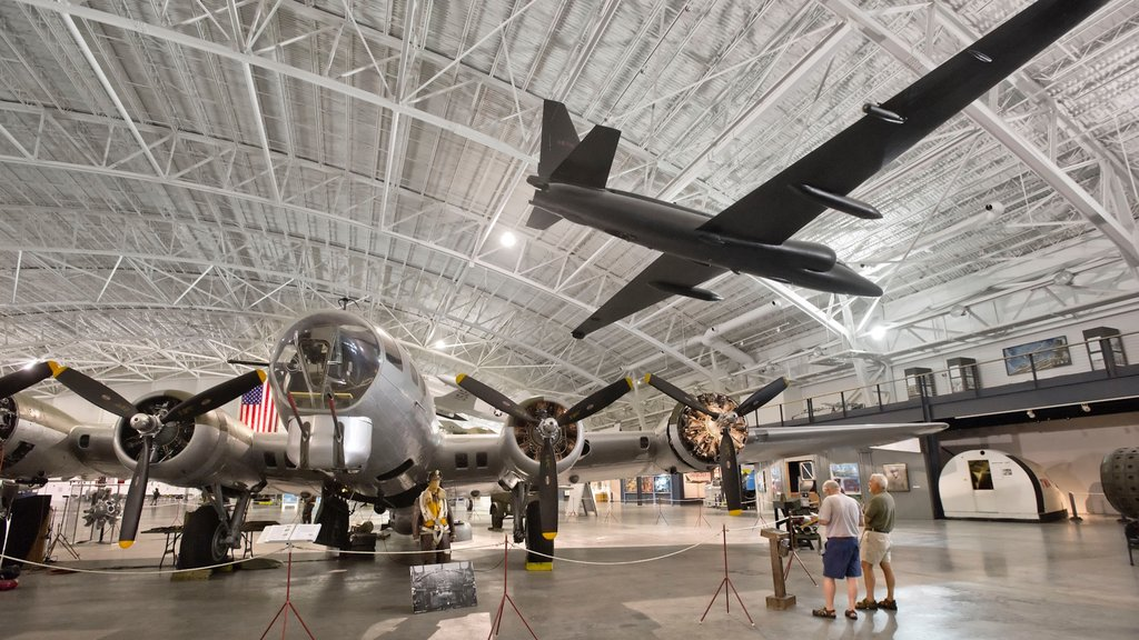 Strategic Air and Space Museum featuring interior views and aircraft as well as a small group of people