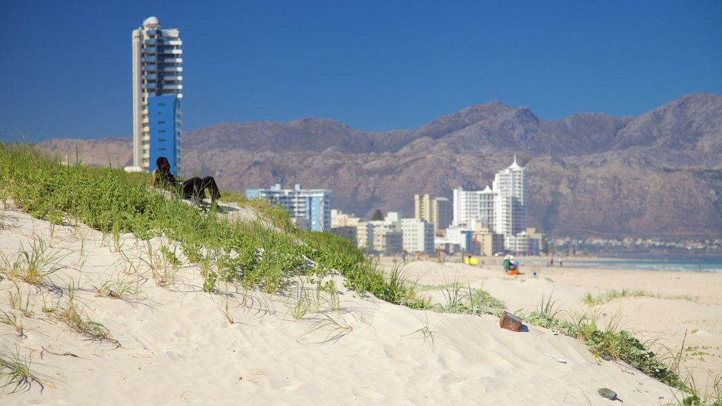 Strand featuring landscape views, mountains and a beach