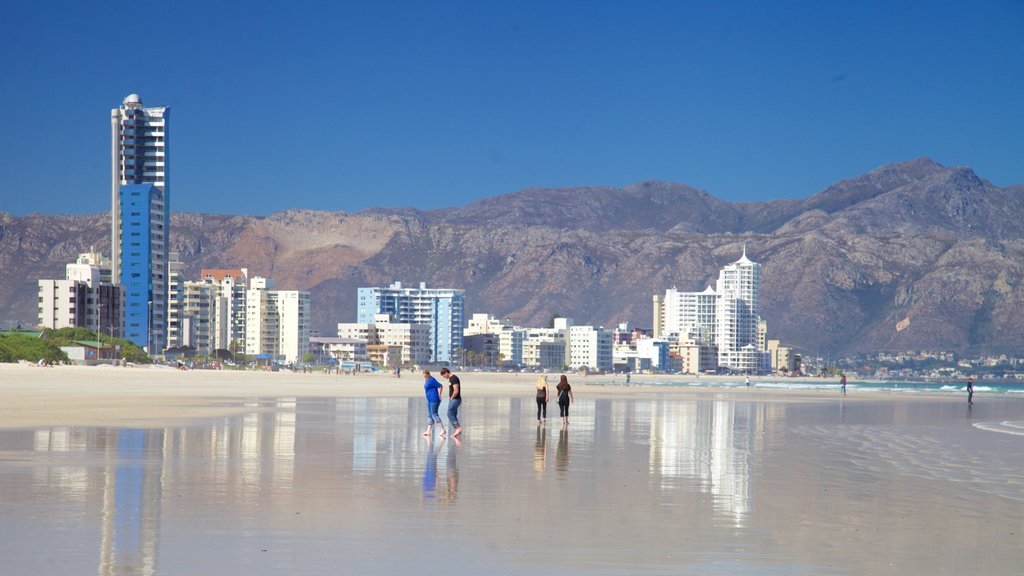 Strand which includes a city, a coastal town and a beach