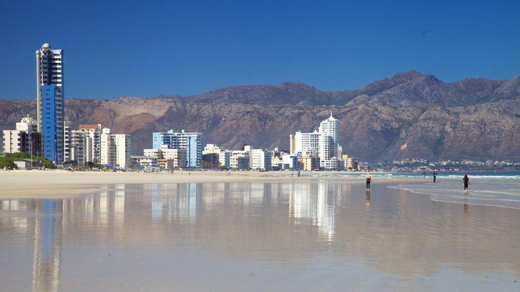 Strand featuring landscape views, a coastal town and a beach