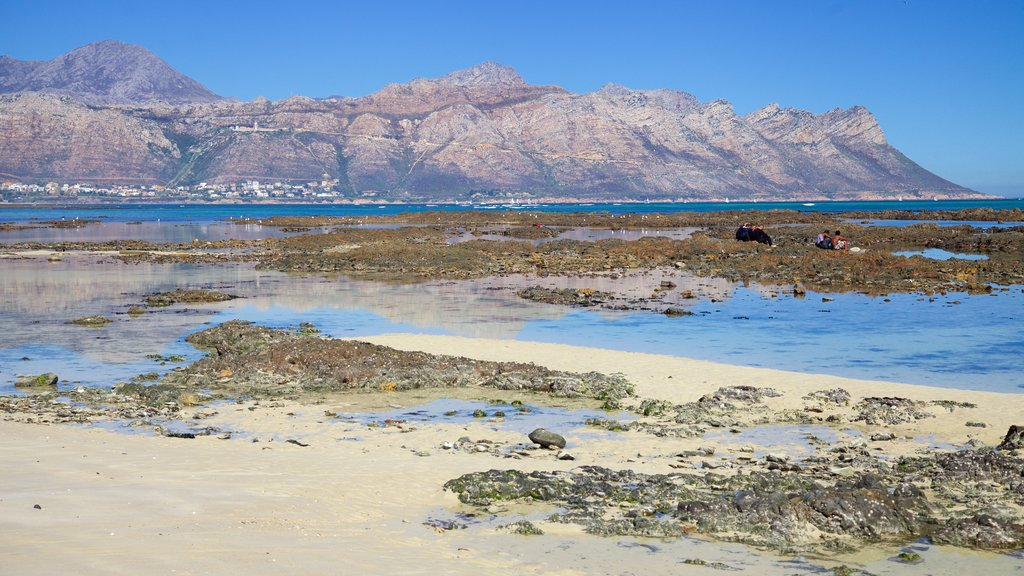 Strand which includes general coastal views, landscape views and mountains