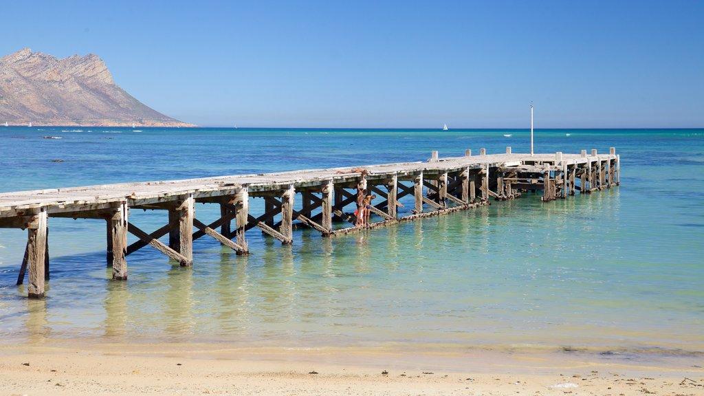 Strand showing a sandy beach and general coastal views