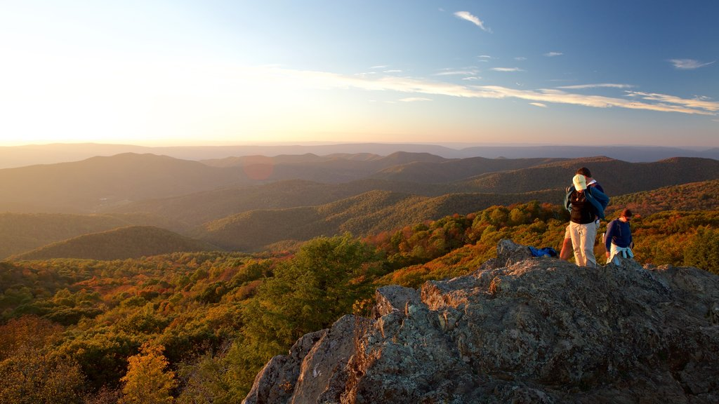 Bearfence Mountain which includes a sunset, landscape views and hiking or walking