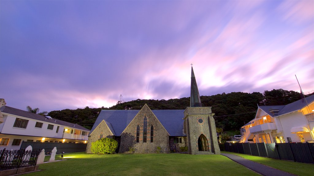 Paihia featuring heritage architecture, a church or cathedral and a sunset