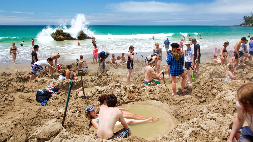 Hot Water Beach showing a sandy beach, surf and a bay or harbor