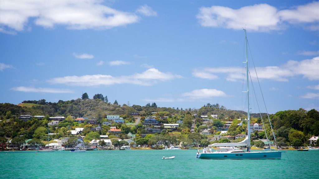 Russell showing a coastal town, sailing and a bay or harbor