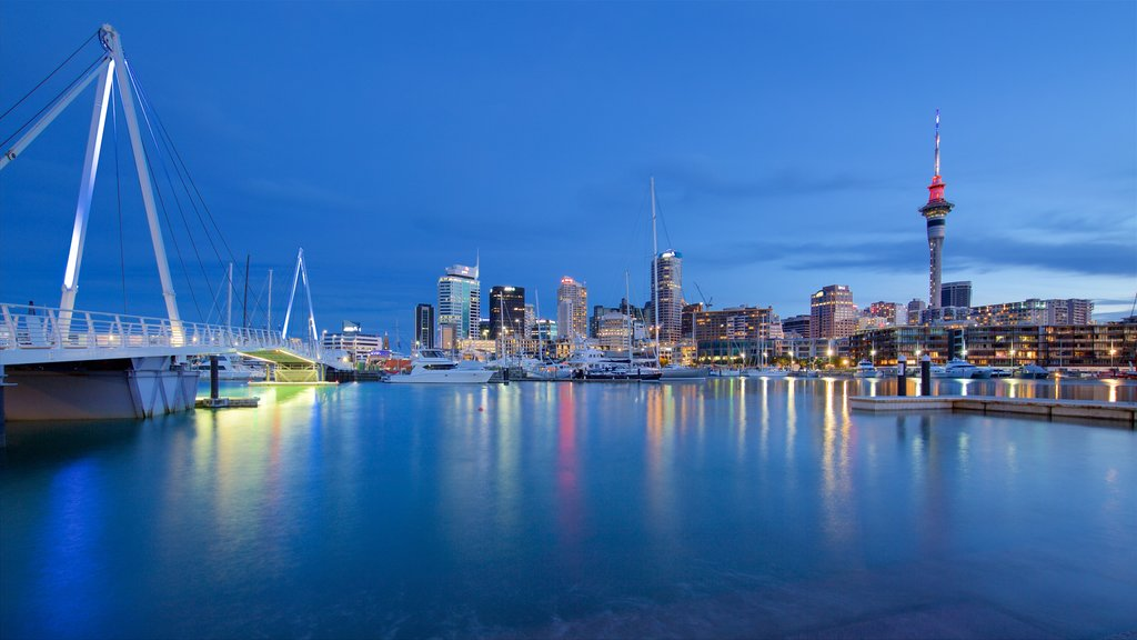 Auckland featuring a bridge, night scenes and a bay or harbor