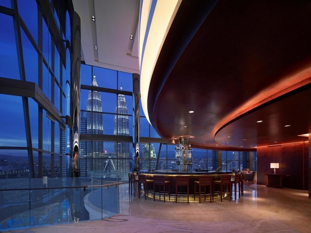 view of the petronas towers at night time from inside the Grand Hyatt Kuala Lumpur hotel bar area