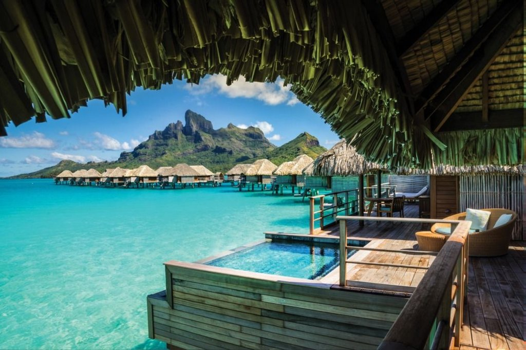 view of bungalows and mountains from a bungalow with a pool at four seasons resort bora bora