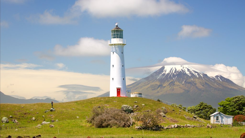Cape Egmont Lighthouse showing a lighthouse, tranquil scenes and mountains