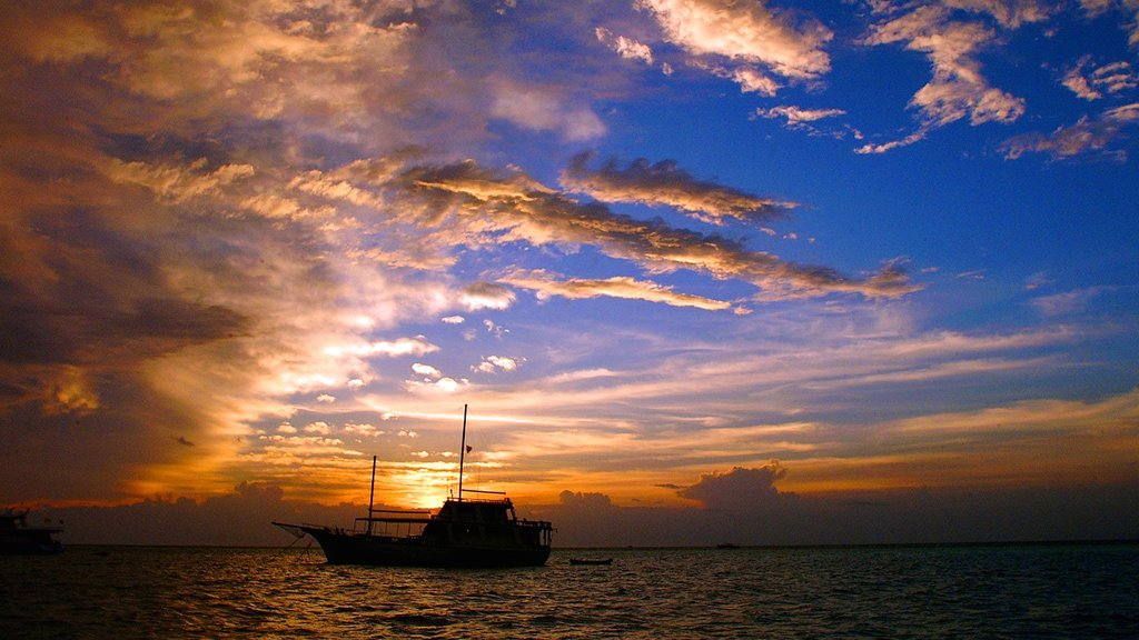 Maldives which includes general coastal views, boating and a sunset
