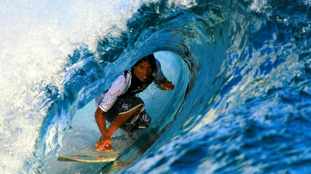 Maldives showing surfing as well as an individual male