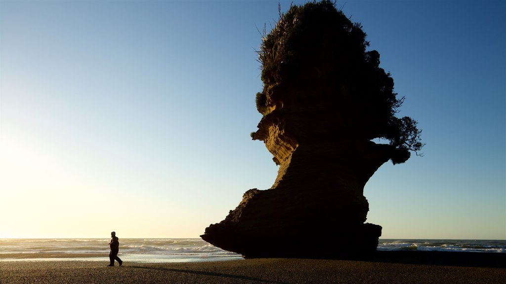 Punakaiki which includes rocky coastline, a sunset and general coastal views