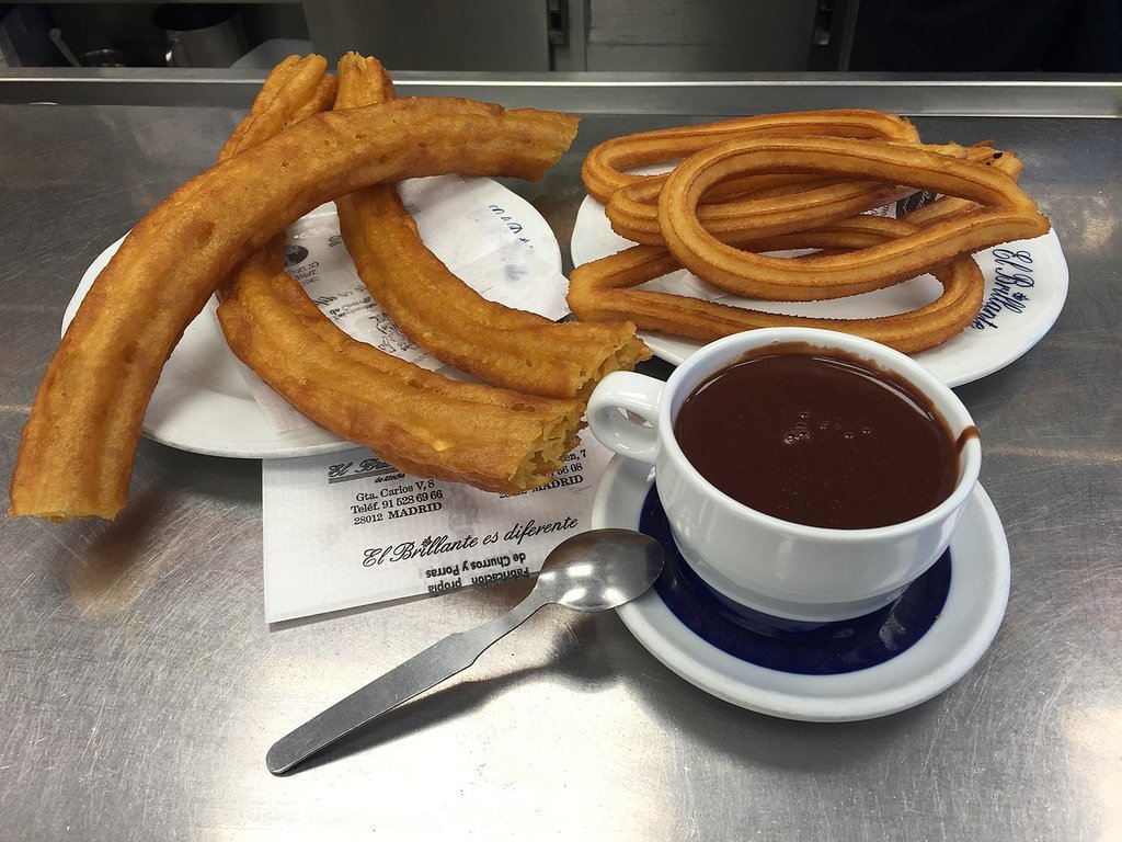 1440px-Chocolate_con_churros_and_purros_%2826770893323%29.jpg?1568190113