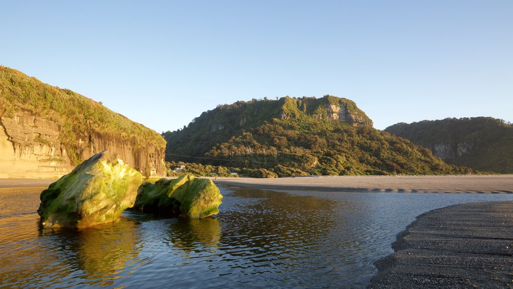 Punakaiki showing rocky coastline, general coastal views and a sandy beach