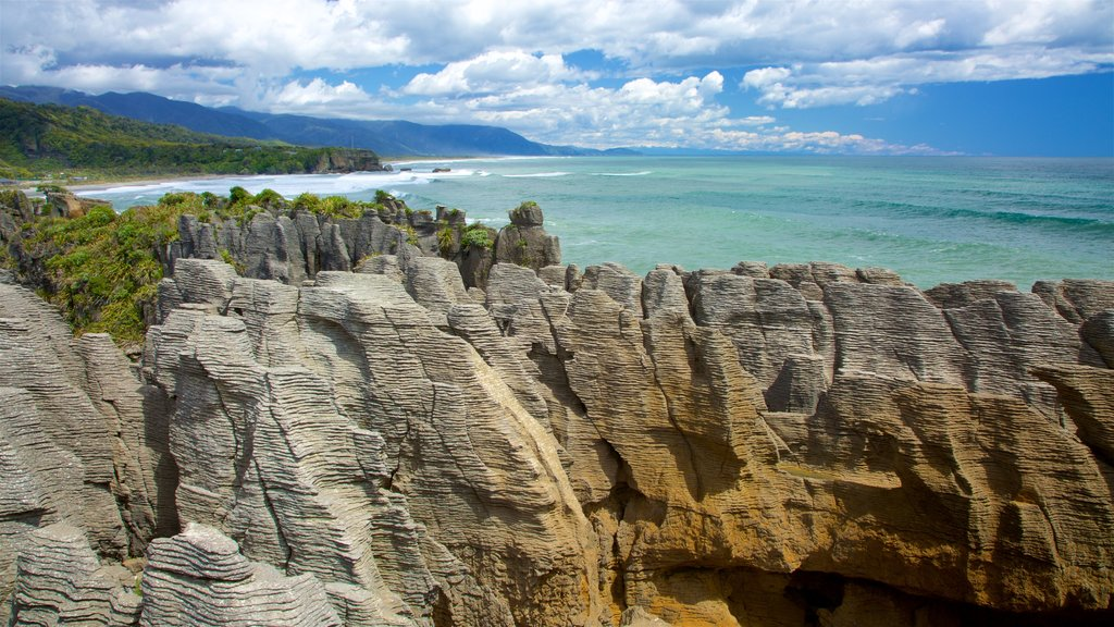 West Coast New Zealand which includes rugged coastline, landscape views and mountains