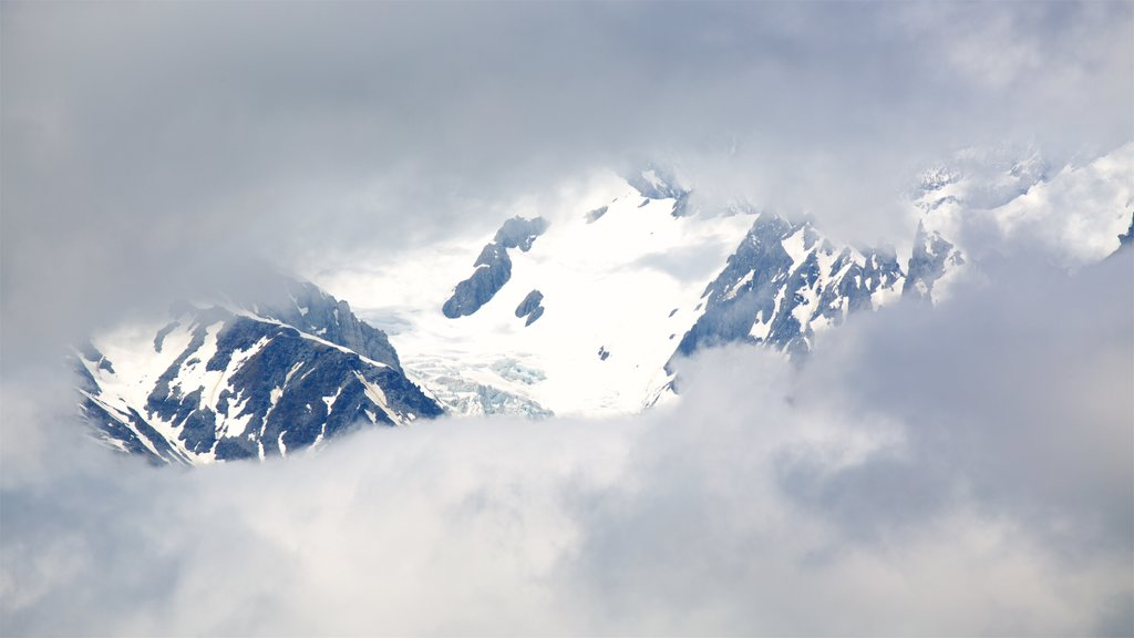 Fox Glacier showing snow, mist or fog and mountains