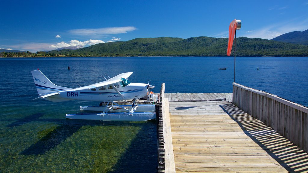 Lake Te Anau showing a lake or waterhole and aircraft