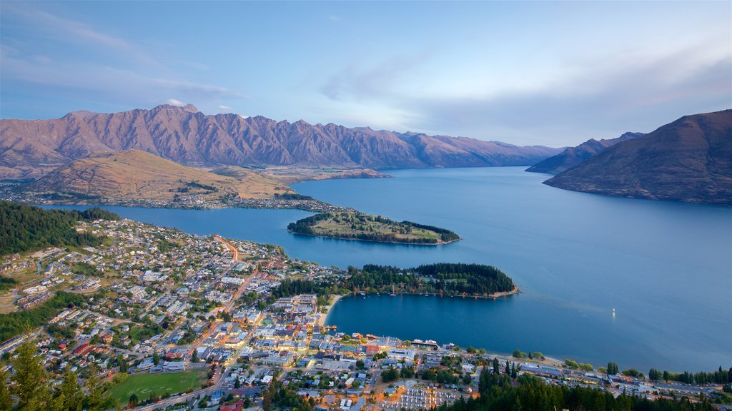 Queenstown showing a small town or village, mountains and a sunset