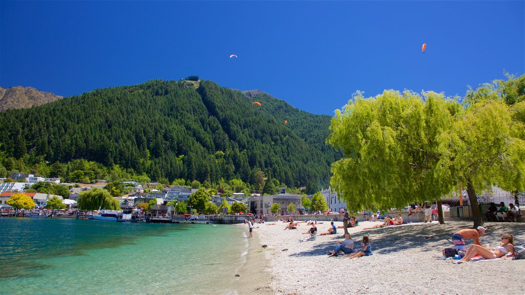 Queenstown Beach featuring a small town or village, a pebble beach and a lake or waterhole