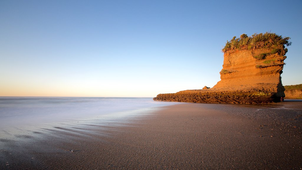 Punakaiki showing a beach, a sunset and rocky coastline
