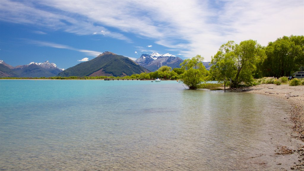 Glenorchy featuring a lake or waterhole, a pebble beach and mountains