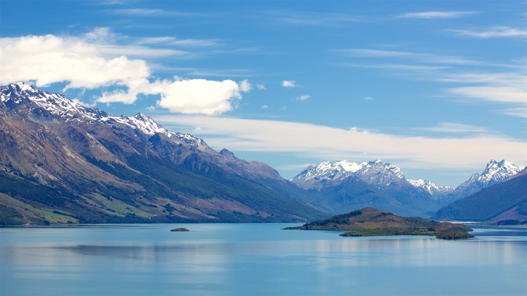 Lake Wakatipu which includes mountains, snow and a lake or waterhole