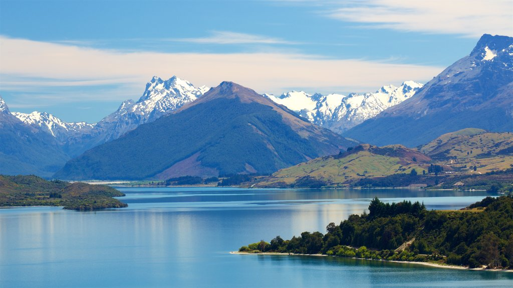 Lake Wakatipu featuring snow, a lake or waterhole and mountains