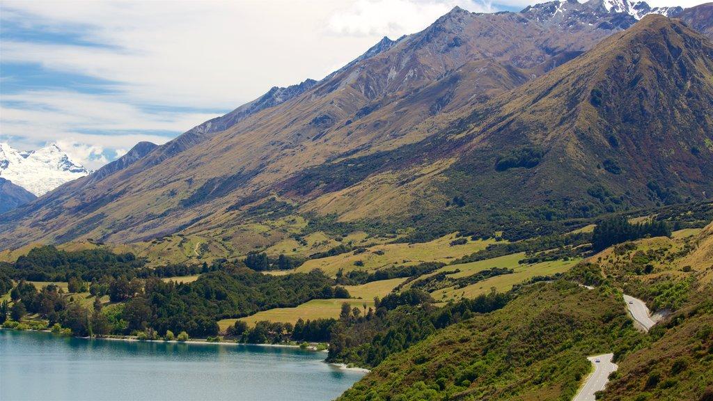 Lake Wakatipu featuring mountains, snow and a lake or waterhole