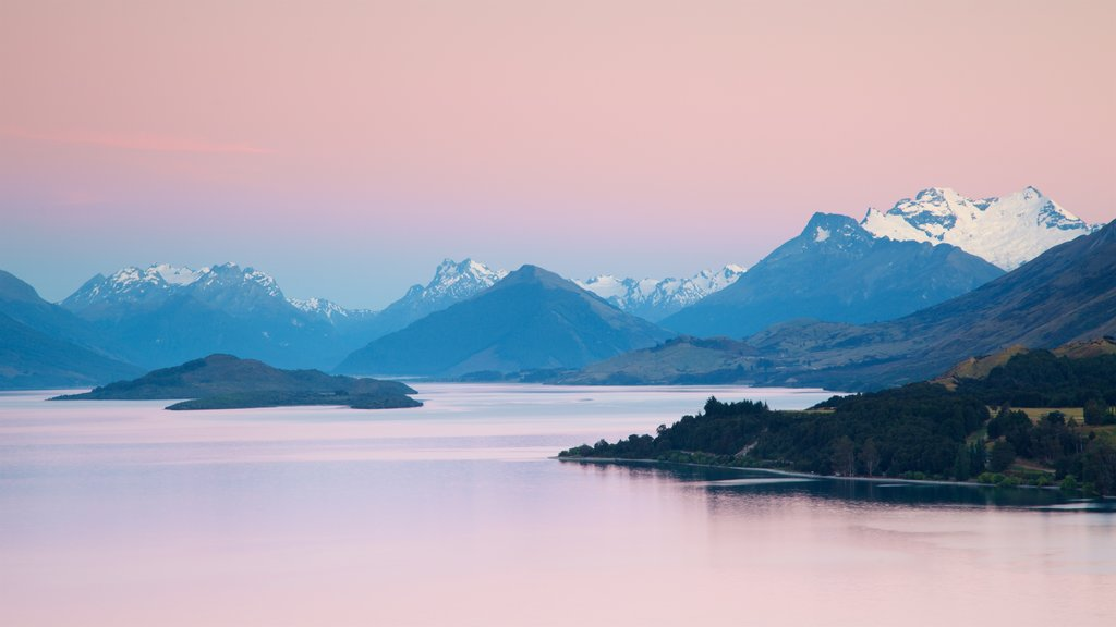 Lake Wakatipu featuring a sunset, snow and a lake or waterhole