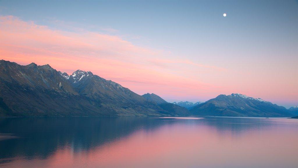 Lake Wakatipu featuring mountains, a sunset and a lake or waterhole