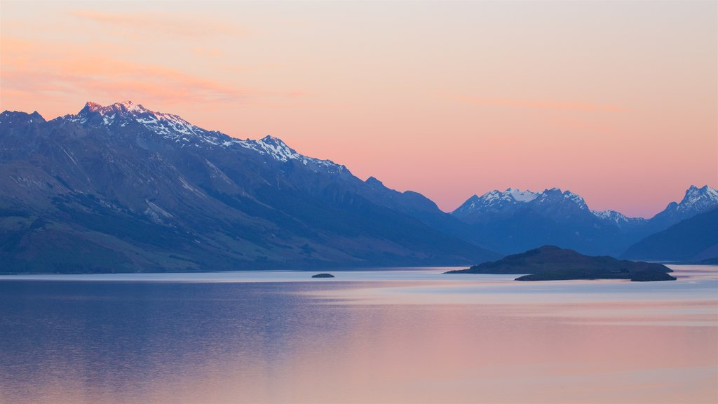 Lake Wakatipu showing mountains, snow and a sunset