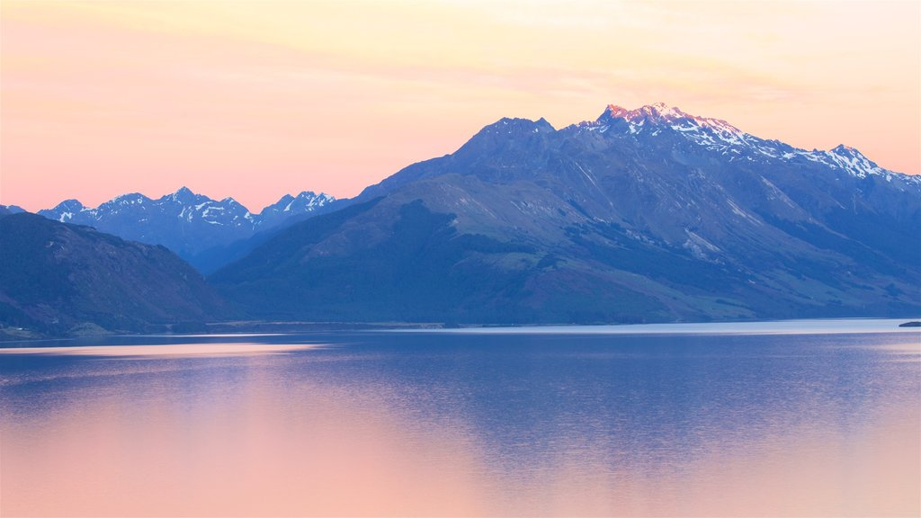 Lake Wakatipu featuring mountains, a lake or waterhole and a sunset