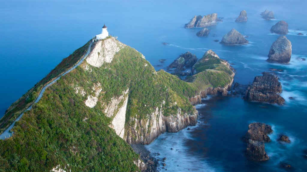 Nugget Point Lighthouse featuring a lighthouse and rocky coastline
