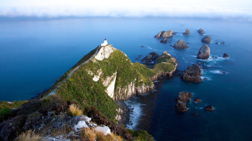 Nugget Point Lighthouse which includes rugged coastline and a lighthouse
