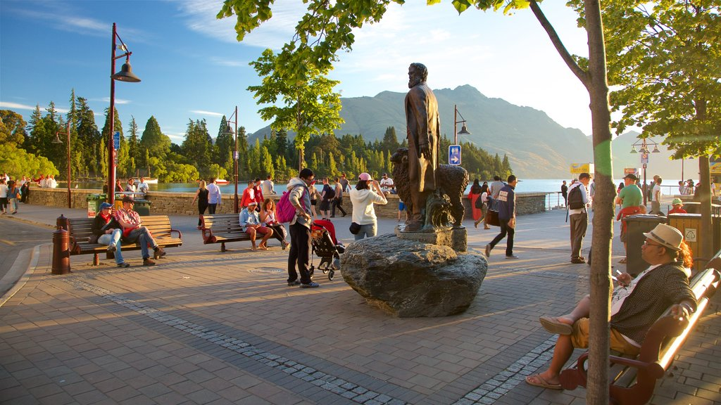 Queenstown City Centre which includes a statue or sculpture, street scenes and a sunset