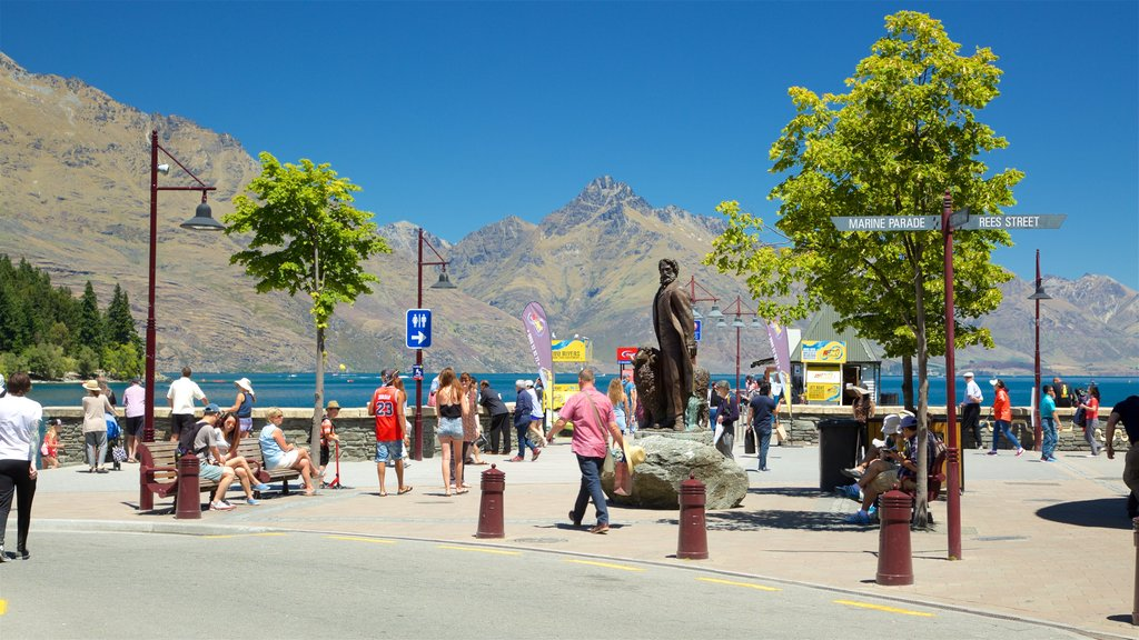 Queenstown Beach showing a lake or waterhole, a monument and mountains