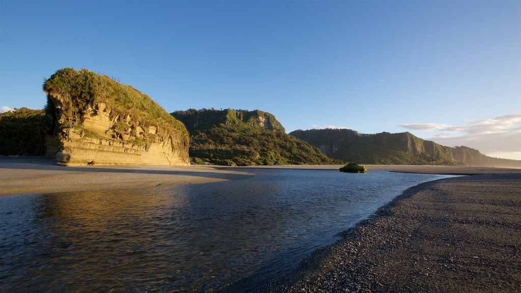 Pororari River Track featuring general coastal views, a river or creek and rugged coastline